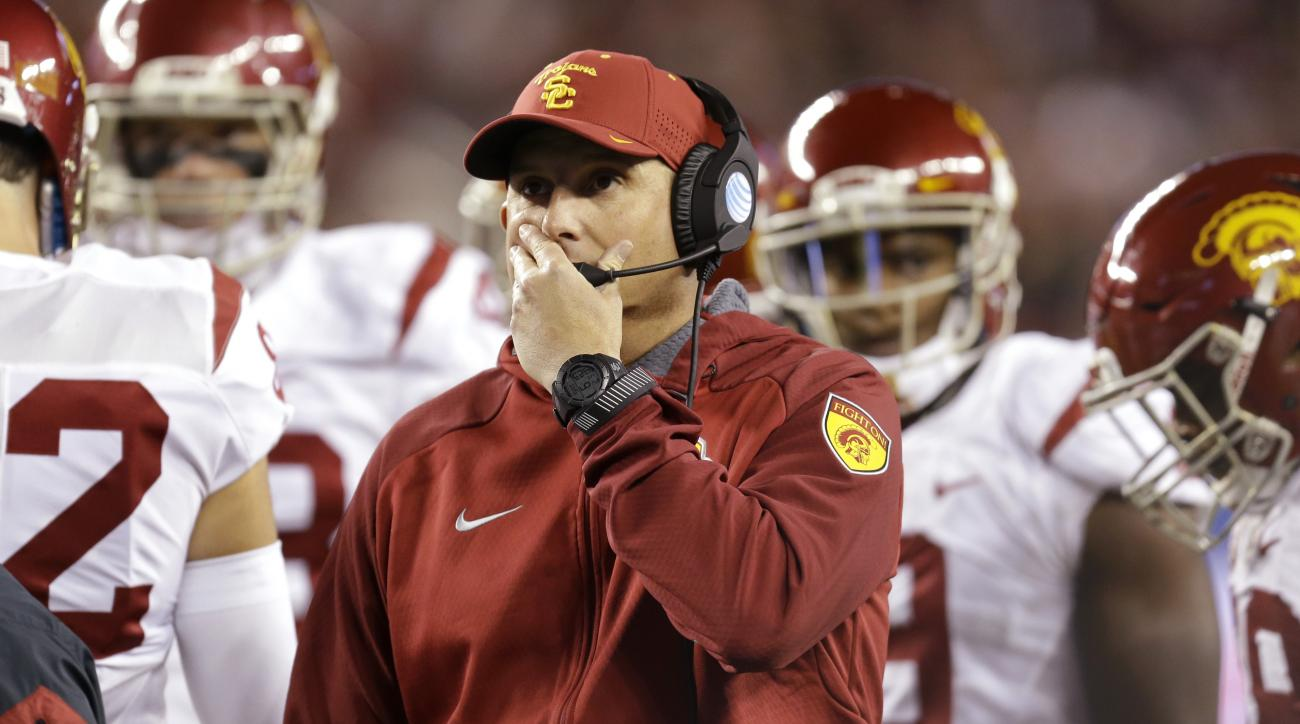 Southern California head coach Clay Helton, center, reacts during the first quarter of a Pac-12 Conference championship NCAA college football game against Stanford, Saturday, Dec. 5, 2015, in Santa Clara, Calif. (AP Photo/Ben Margot)