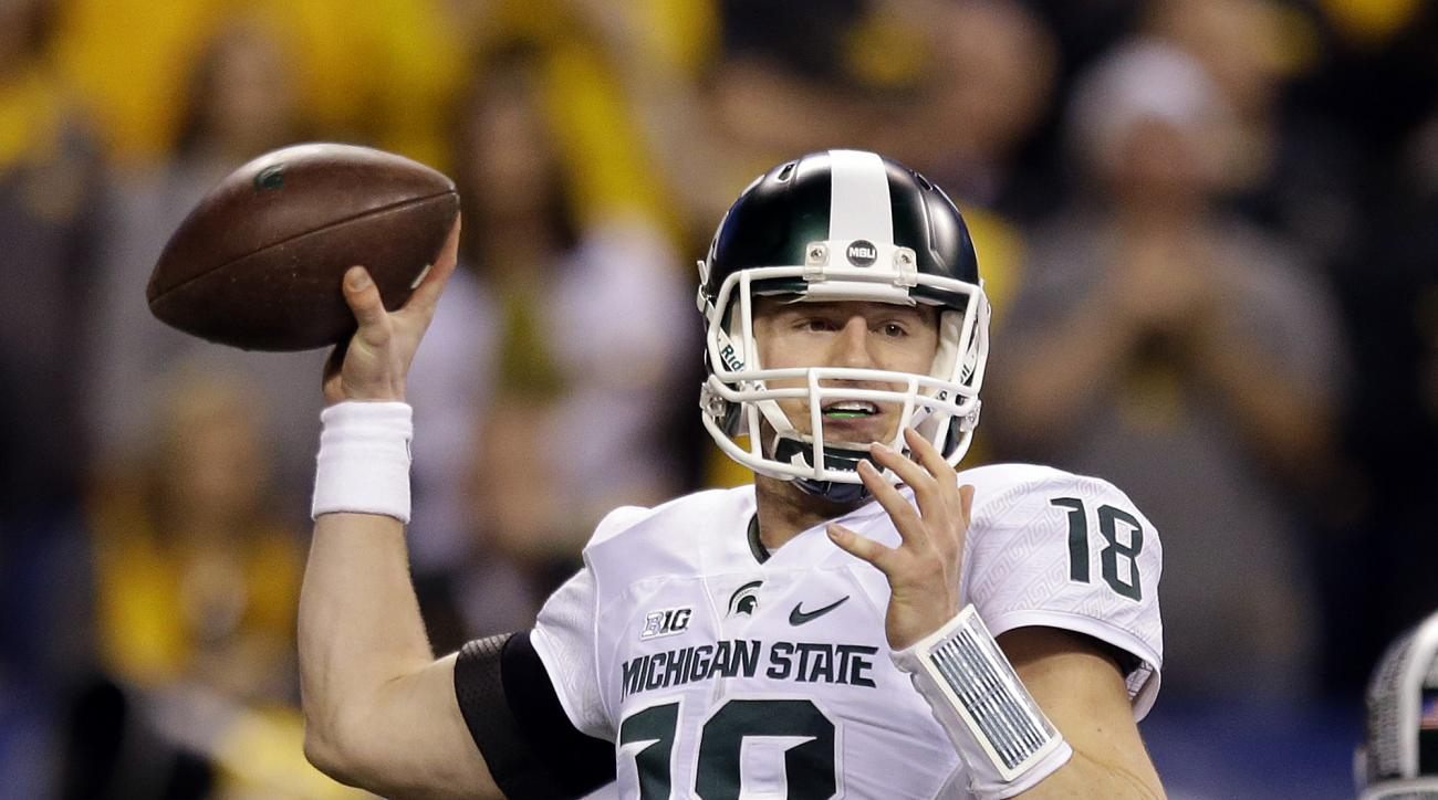 Michigan State quarterback Connor Cook throws during the first half of the Big Ten championship NCAA college football game against Iowa, Saturday, Dec. 5, 2015, in Indianapolis. (AP Photo/Michael Conroy)