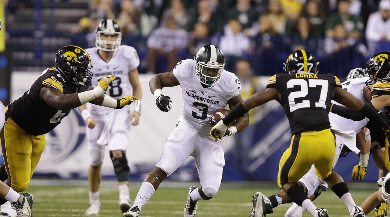 Michigan State running back LJ Scott (3) carries during the second half against Iowa in the Big Ten championship NCAA college football game Saturday, Dec. 5, 2015, in Indianapolis. (AP Photo/Michael Conroy)