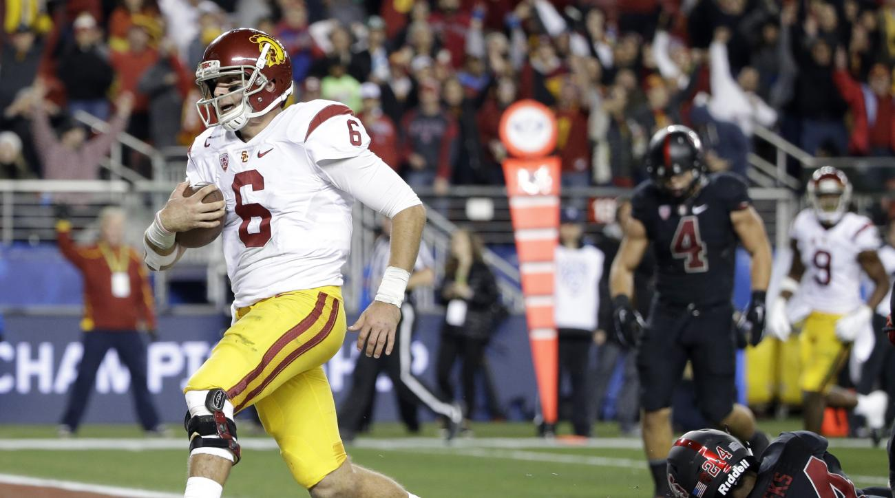 Southern California quarterback Cody Kessler (6) scores on a 12-yard run against Stanford during the second half of a Pac-12 Conference championship NCAA college football game Saturday, Dec. 5, 2015, in Santa Clara, Calif. Stanford won 41-22. (AP Photo/Ma
