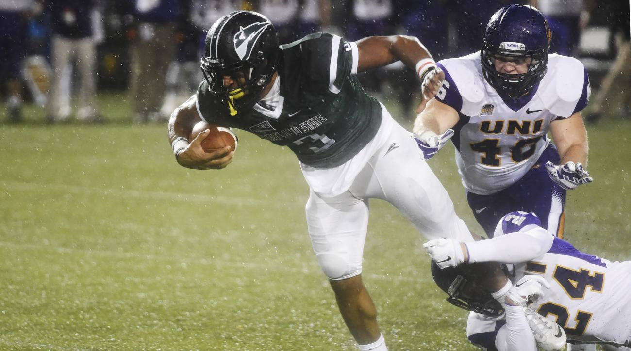 Portland State running back David Jones (3) is brought down by Northern Iowa defensive back Tim Kilfoy (24) and linebacker Jared Farley (46) during the first half of a second-round NCAA FCS playoff game at Providence Park on Saturday, Dec. 5, 2015, in Por