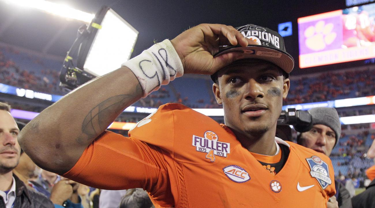 Clemson quarterback Deshaun Watson celebrates after Clemson defeated North Carolina 45-37 in the Atlantic Coast Conference championship NCAA college football game in Charlotte, N.C., early Sunday, Dec. 6, 2015. (AP Photo/Gerry Broome)