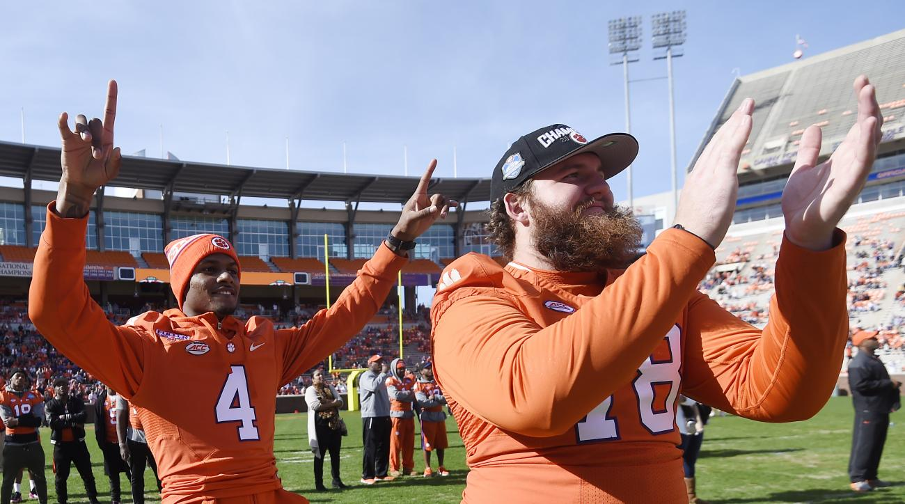 Clemson football quarterback Deshaun Watson, left, and offensive guard Eric Mac Lain celebrate during a pizza party celebrating Selection Sunday at Memorial Stadium, Sunday, Dec. 6, 2015, in Clemson, S.C. (AP Photo/Rainier Ehrhardt)