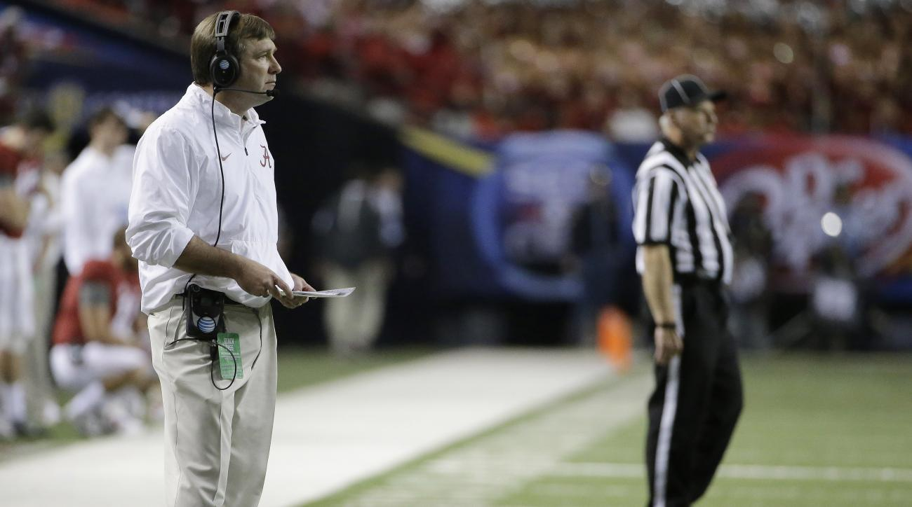 In this Saturday, Dec. 5, 2015 photo, Alabama defensive coach Kirby Smart watches play against Florida during the first half of the Southeastern Conference championship NCAA college football game, in Atlanta. Georgia hired Smart as its new head coach on S