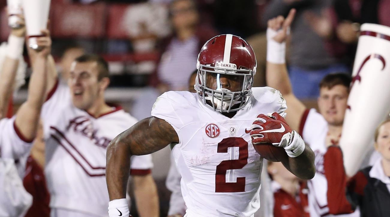 File-This Nov. 14, 2015, shows Alabama running back Derrick Henry (2) looking across the field for any Mississippi State defenders on his way to a 65-yard touchdown during the second half of an NCAA college football game in Starkville, Miss. Henry, Clemso