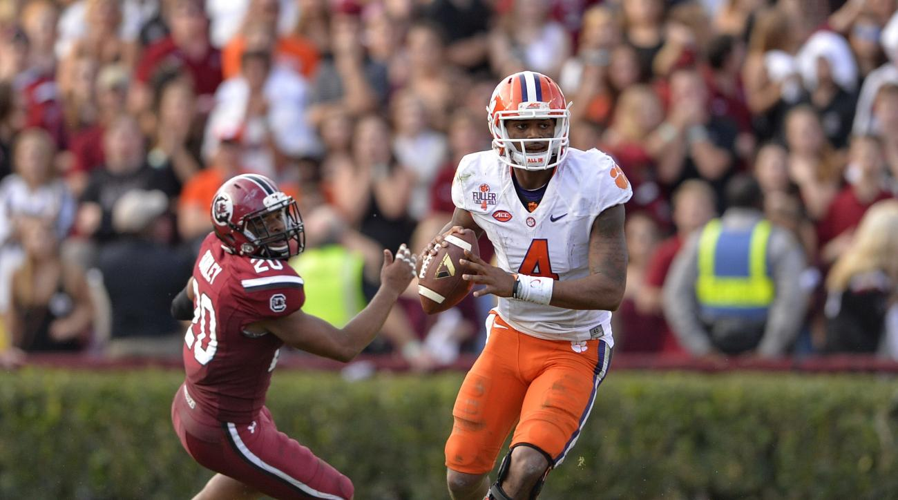 File-This Nov. 28, 2015, file photo shows Clemson quarterback Deshaun Watson scrambling out of the pocket looking for a receiver during the second half of an NCAA college football game against South Carolina in Columbia, S.C.  Alabama running back Derrick