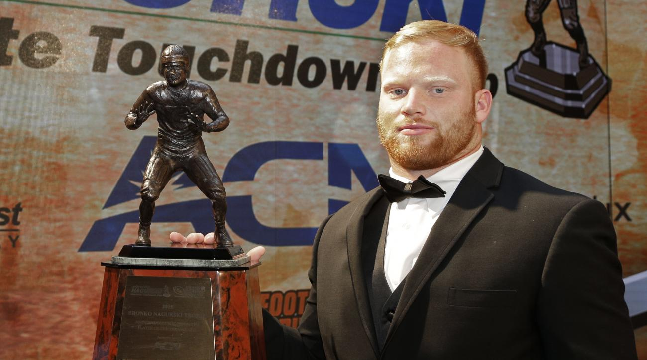 Temple's Tyler Matakevich poses with the Bronko Nagurski Award for the nation's top NCAA college football defensive player during a news conference before the award ceremony in Charlotte, N.C., Monday, Dec. 7, 2015. (AP Photo/Chuck Burton)