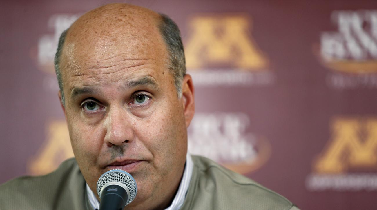 FILE - In this Oct. 10, 2013, file photo, Minnesota athletic director Norwood Teague speaks at a news conference in Minneapolis. Two examinations of the University of Minnesota's athletics department will become public Tuesday, Dec. 8, offering new inform