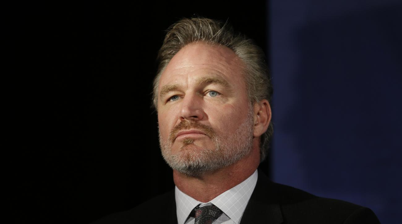 FILE - In this Jan. 9, 2015, file photo, former Oklahoma linebacker Brian Bosworth listens during a news conference announcing the 2015 College Football Hall of Fame Class, in Dallas. Bosworth's College Football Hall of Fame induction was a milestone that