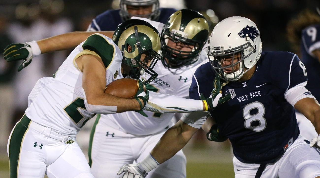 FILE - In this Oct. 11, 2014, file photo, Colorado State's Joe Hansley (25) runs against Nevada defender Ian Seau (8) during the first half of an NCAA college football game in Reno, Nev. Colorado State's Sam Carlson (71) is at rear. - Mountain West offici