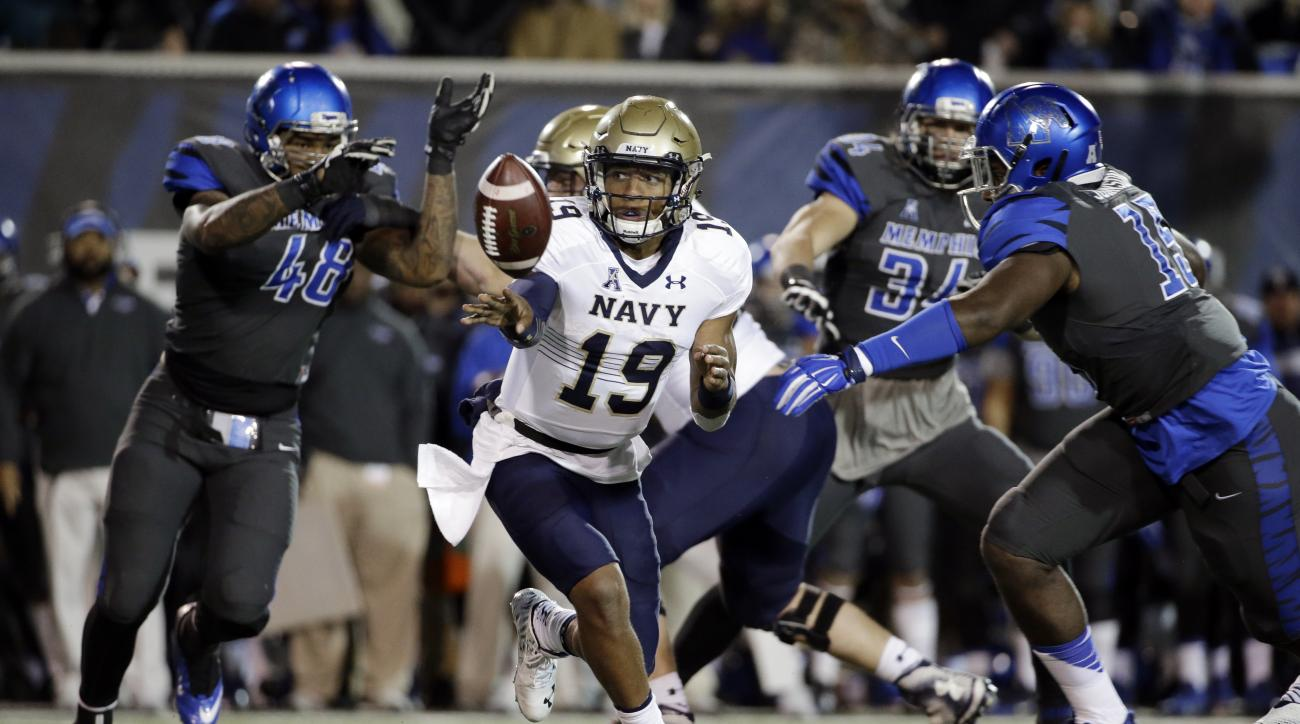FILE - In this Nov. 7, 2015, file photo, Navy quarterback Keenan Reynolds (19) playing against Memphis in the first half of an NCAA college football game in Memphis, Tenn.  Keenan Reynolds has already enjoyed a sensational, record-setting career at Navy.