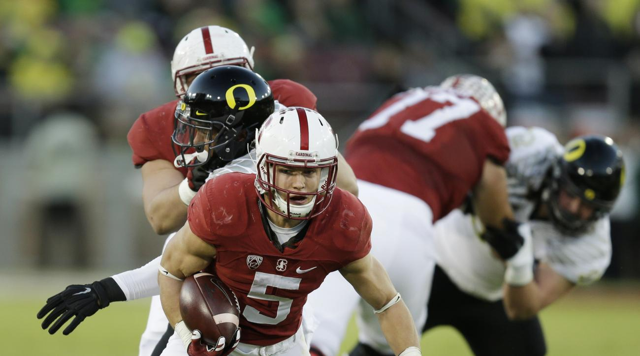 FILE - In this Dec. 5, 2015, file photo, Stanford's Christian McCaffrey (5) is tackled by Oregon's Alex Balducci during the first quarter of a Pac-12 Conference championship NCAA college football game in Santa Clara, Calif. McCaffrey celebrated with his t
