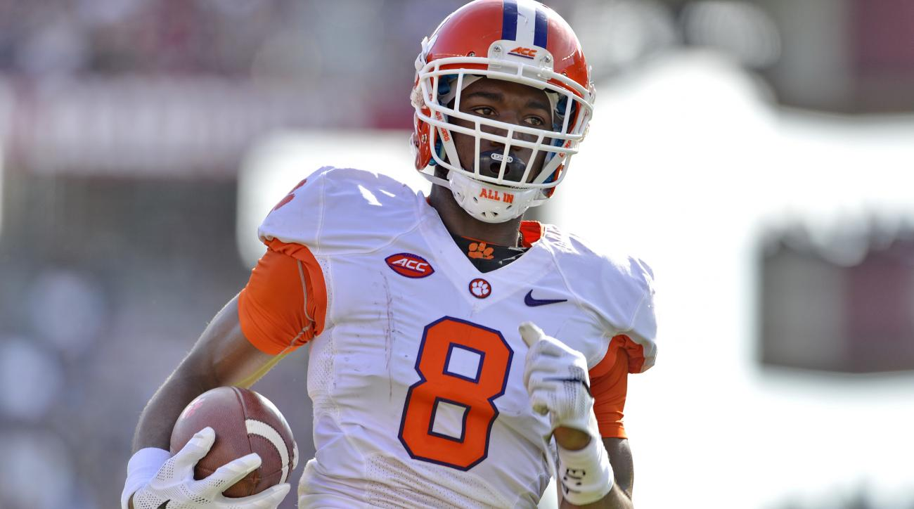 FILE - In this Nov. 28, 2015 file photo, Clemson's Deon Cain runs in a 55-yard pass play for a touchdown during the first half of an NCAA college football game against South Carolina, in Columbia, S.C. Clemson co-offensive coordinator Jeff Scott wasn't qu