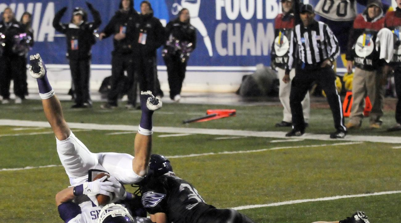 FILE - In this Dec. 16, 2011 file photo, Mount Union's A.J. Claycomb scores a touchdown against Wisconsin-Whitewater's Jared Kiesow in the second half of the NCAA Division III national championship college football game in Salem, Va. Mount Union always se