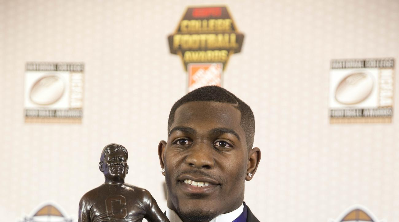 Iowa's Desmond King poses with the trophy after winning the Jim Thorpe Award for the being the nation's best defensive back at the College Football Hall of Fame, Thursday, Dec. 10, 2015, in Atlanta. (AP Photo/John Bazemore)