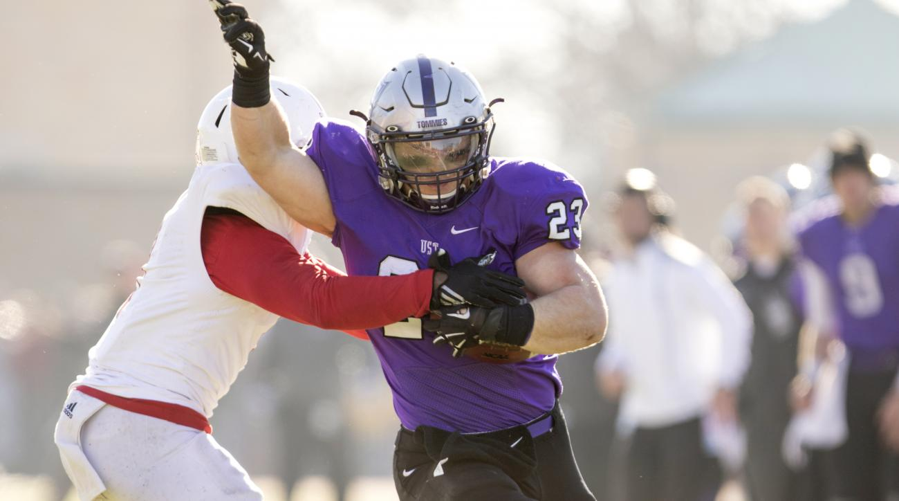 In this photo taken on Nov. 28, 2015, St. Thomas running back Jordan Roberts (23) runs near the goal line during an NCAA Division III college football game against St. John University, in St. Paul. Minn. Roberts transferred from the FCS level at South Dak