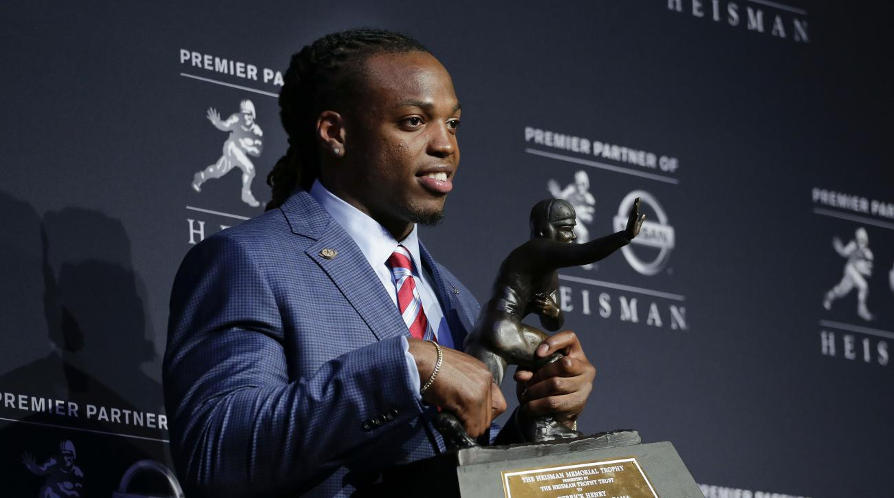 Alabama's Derrick Henry poses for photos after winning the Heisman Trophy, Saturday, Dec. 12, 2015, in New York. (AP Photo/Julie Jacobson)