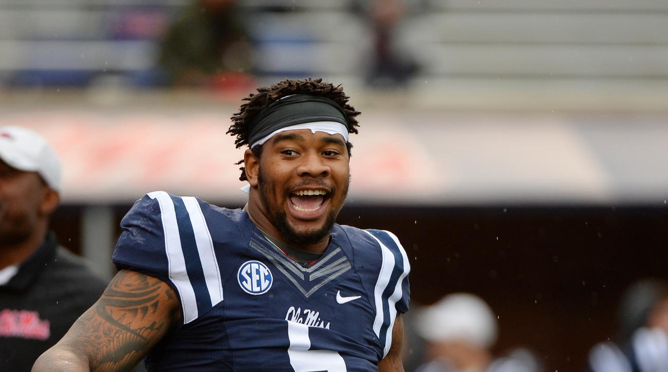 Mississippi defensive tackle Robert Nkemdiche (5) stretches before an NCAA college football game between Mississippi and Arkansas in Oxford, Miss., Saturday, Nov. 7, 2015. (AP Photo/Thomas Graning)