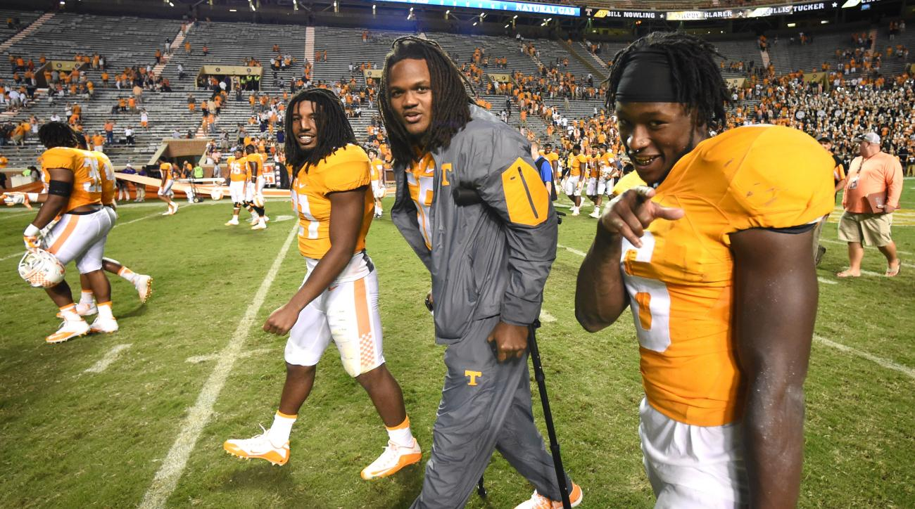 In this Sept. 19, 2015, photo, Tennessee players Jalen Reeves-Maybin, left, Curt Maggitt, and Alvin Kamara (6) leave the field after the Vols' 55-10 victory over Western Carolina, in Knoxville, Tenn. Tennessee defensive end/linebacker Curt Maggitt remains