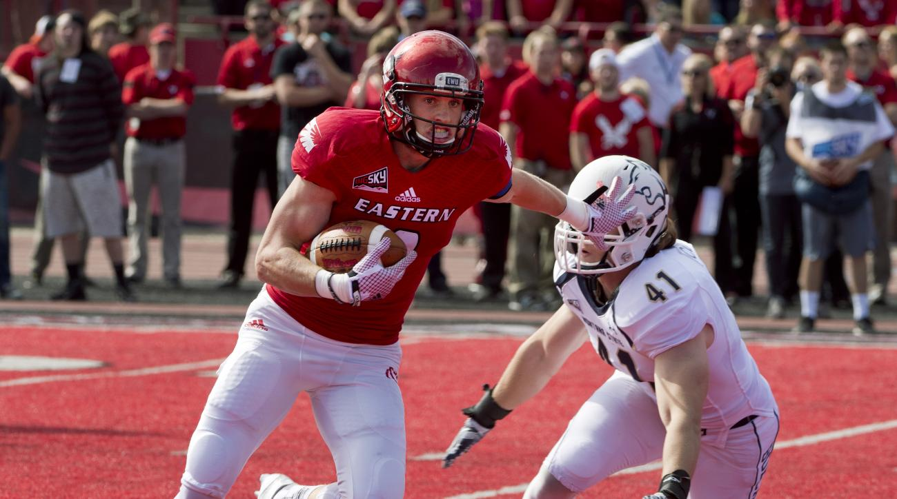 FILE - In this Sept. 19, 2015, file photo, Eastern Washington's Cooper Kupp runs past Montana State's Grant Collins after a reception during the first half of an NCAA college football game, in Cheney, Wash. Kupp has been named to The Associated Press FCS