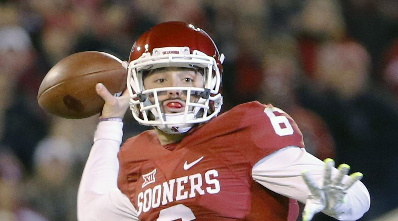FILE - In this Nov. 21, 2015, file photo, Oklahoma quarterback Baker Mayfield (6) looks to pass against TCU during the first quarter of an NCAA college football game in Norman, Okla. Oklahoma quarterback Baker Mayfield is the unanimous pick as the Big 12