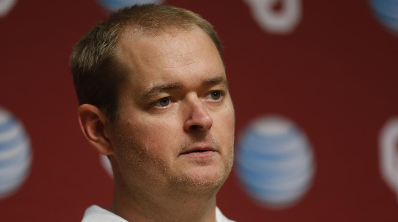 In this Saturday, Aug. 2, 2014 photo, Josh Heupel, Oklahoma co-offensive coordinator and quarterbacks coach, answers a question during media day in Norman, Okla. (AP Photo/Sue Ogrocki)