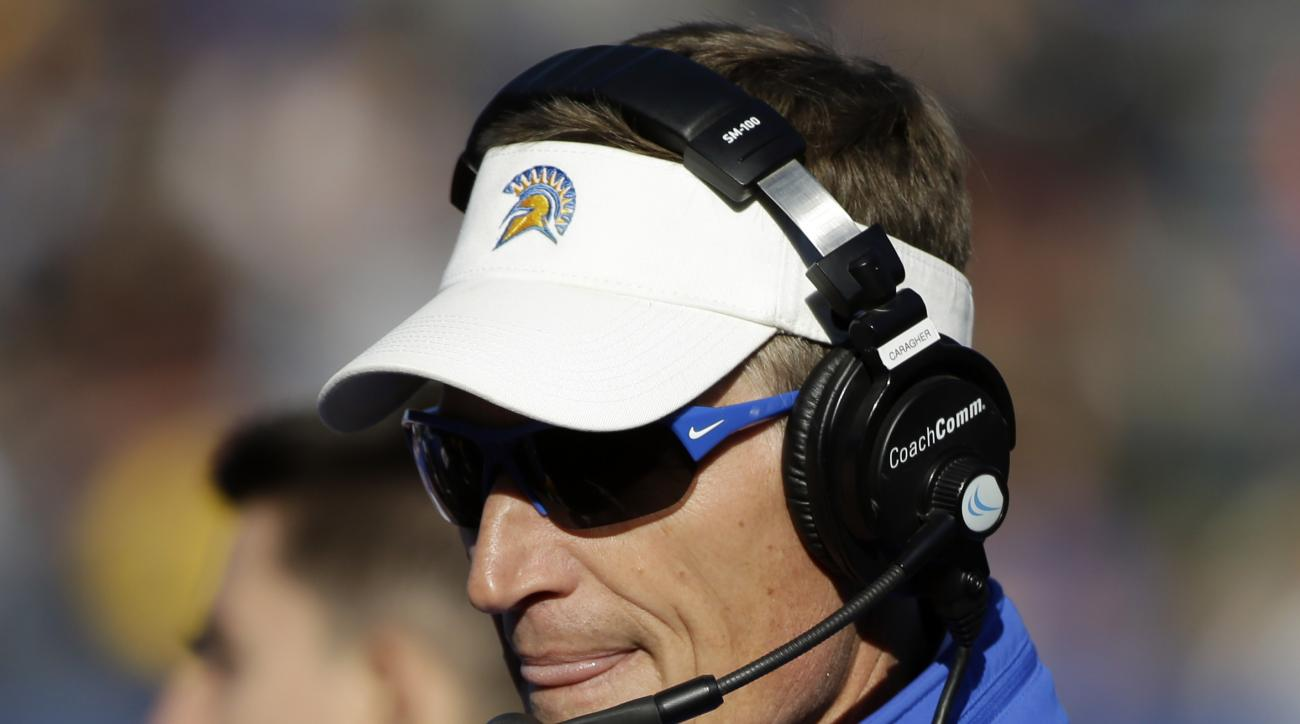 FILE - In this Nov. 27, 2015, file photo, San Jose State head coach Ron Caragher applauds for his team during the first half of an NCAA college football game against Boise State, in San Jose, Calif. The inaugural Cure Bowl is about more than football for