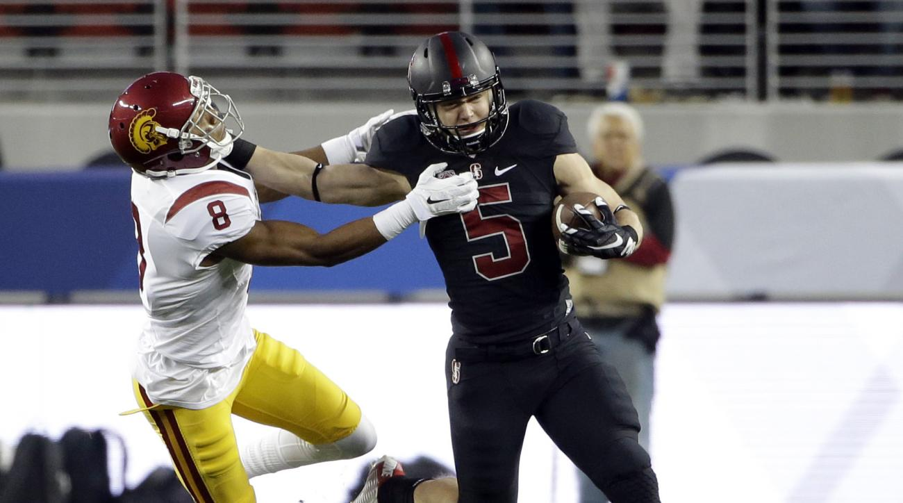 FILE - In this Dec. 5, 2015, file photo, Stanford running back Christian McCaffrey (5) tries to get past Southern California's Iman Marshall (8) during the Pac-12 Conference championship NCAA college football game against, in Santa Clara, Calif. McCaffrey