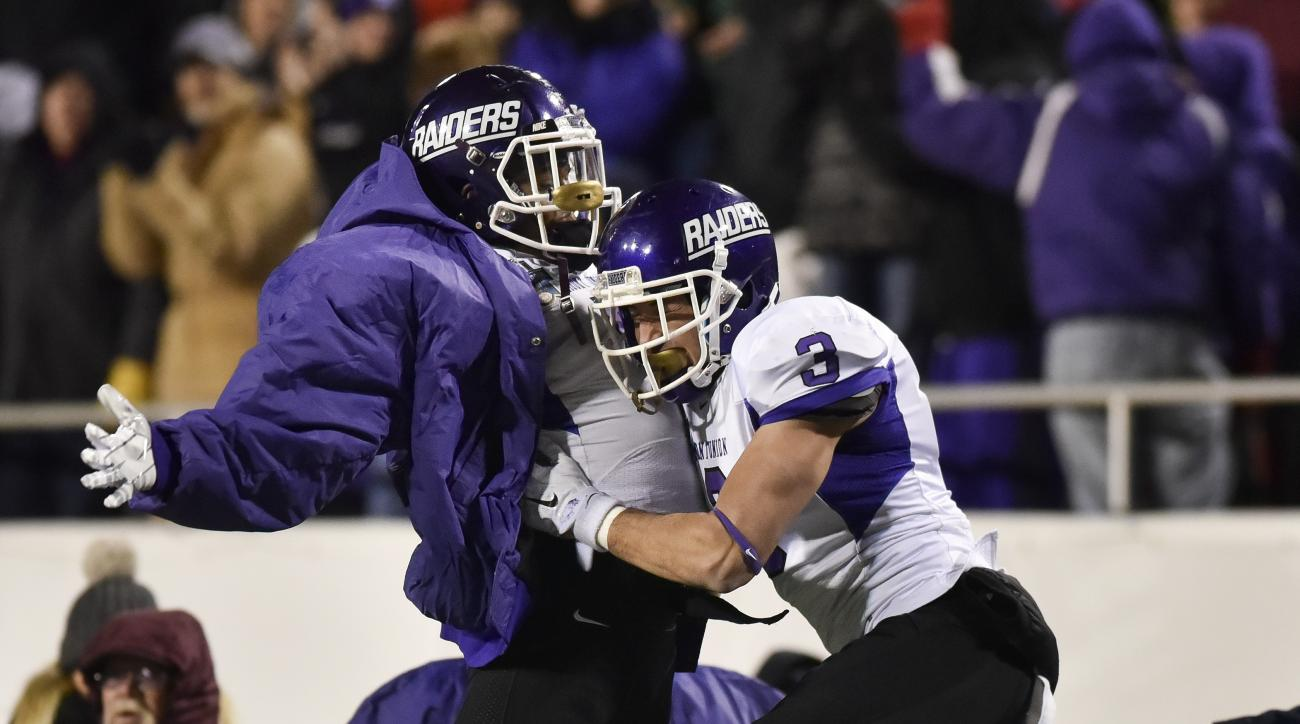 Mount Union wide receiver Roman Namdar (3) celebrates his touchdown reception with defensive back Tre Jones, against St. Thomas during the first half of the NCAA Division III football championship game in Salem, Va., Friday, Dec. 18, 2015. (AP Photo/Micha