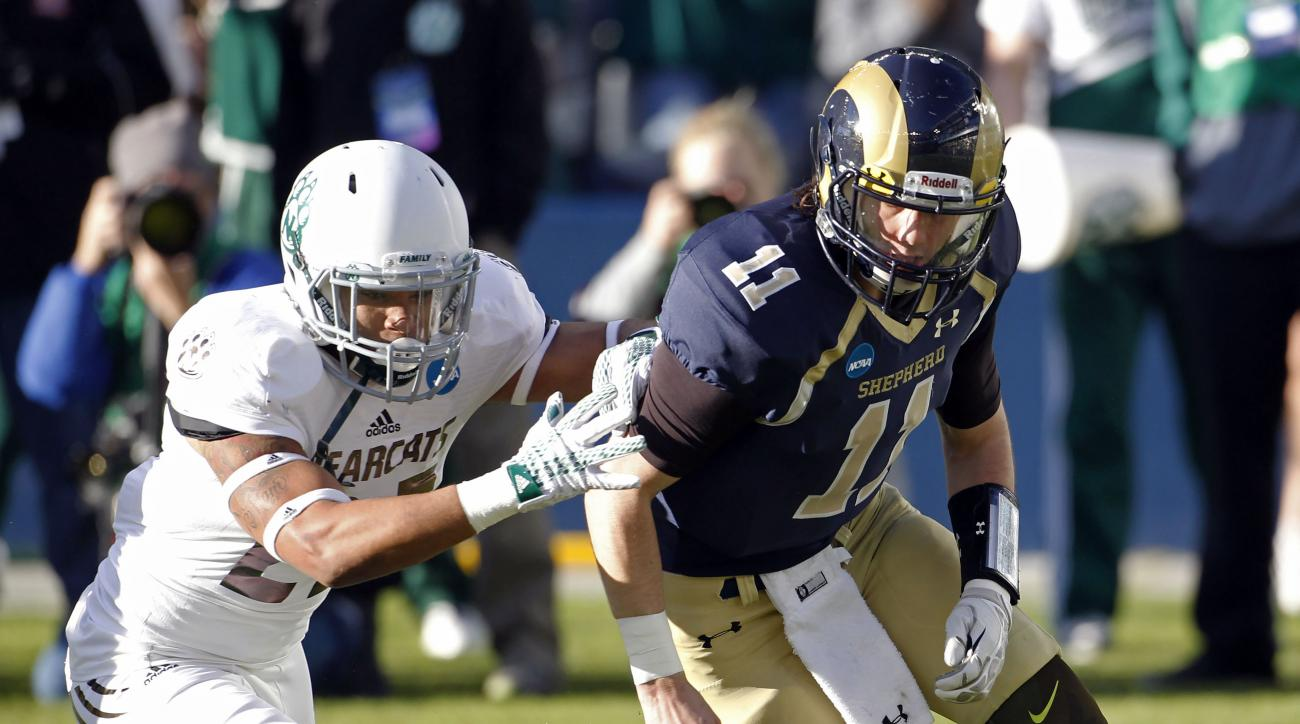 Shepherd quarterback Jeff Ziemba, right,  fumbles the ball as Northwest Missouri linebacker Jarrod Bishop,left, closes in, in the first half of the NCAA Division II Championship football game, Saturday, Dec. 19, 2015, in Kansas City, Kan. Missouri recover