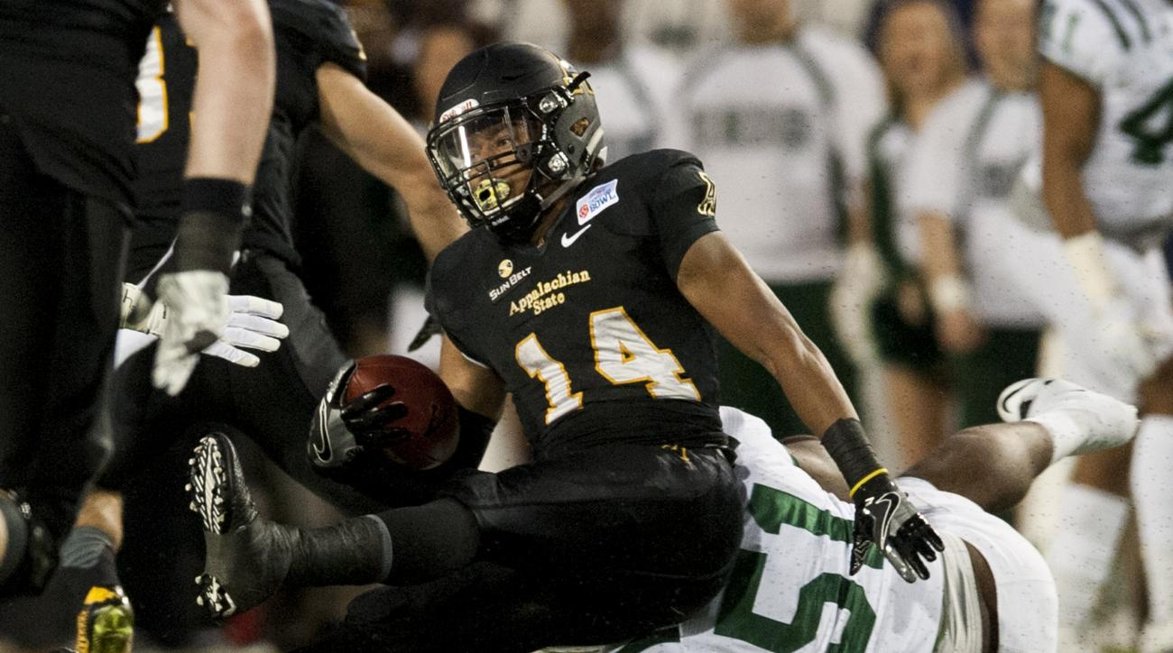 Appalachian State running back Marcus Cox (14) is pulled down by Ohio linebacker Jovon Johnson (51) in the Camellia Bowl NCAA college football game in Montgomery, Ala., Saturday, Dec. 19, 2015. (Mickey Welsh/The Montgomery Advertiser via AP)  NO SALES; MA