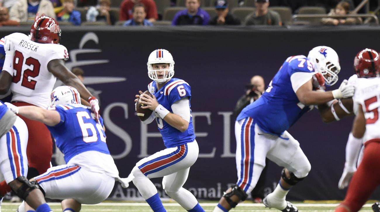 Louisiana Tech quarterback Jeff Driskel (6) looks to pass against Arkansas State during the first half of the New Orleans Bowl NCAA college football game Saturday, Dec. 19, 2015, in New Orleans. (AP Photo/Parker Waters)