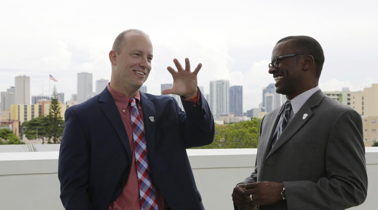 FILE - In this Thursday, Dec. 10, 2015, file photo, Western Kentucky head coach Jeff Brohm, left, and South Florida head coach Willie Taggart speak before a news conference for the Miami Beach Bowl in Miami. The two schools face each other in the Miami Be