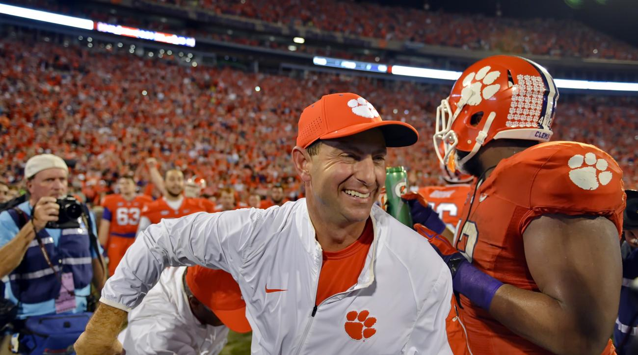FILE - In this Nov. 7, 2015, file photo, Clemson head coach Dabo Swinney celebrates after their 23-17 win over Florida State in an NCAA college football game in Clemson,  S.C. Swinney has been named the AP coach of the year, Monday, Dec. 21, after leading