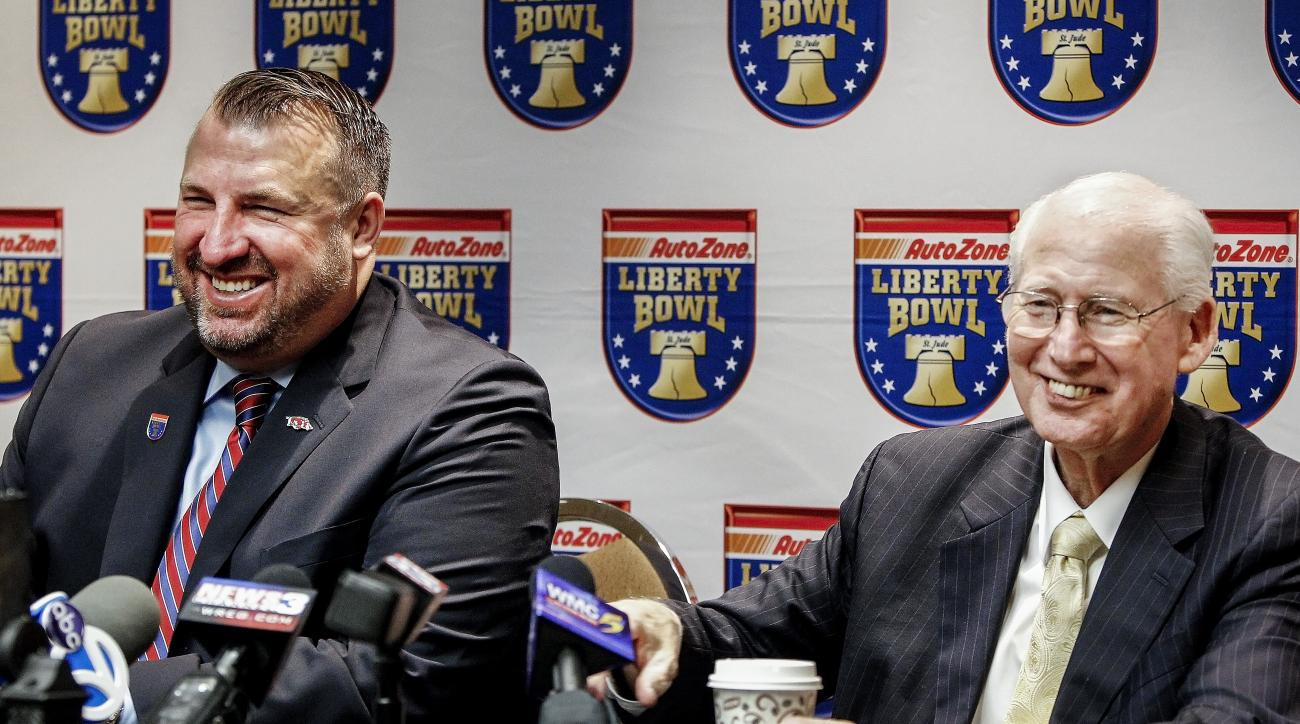 FILE - In this Dec. 10, 2015, file photo, Arkansas coach Bret Bielema, right, and Kansas State coach Bill Snyder, left, take part during a news conference for their teams' upcoming Liberty Bowl NCAA college football appearance in Memphis, Tenn. Arkansas h