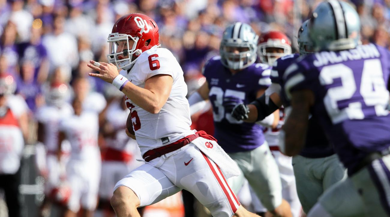 FILE - In this Oct. 17, 2015, file photo, Oklahoma quarterback Baker Mayfield carries the ball during his team's NCAA college football game against Kansas State in Manhattan, Kan. Mayfield has been awarded the Burlsworth Trophy, annually given to college
