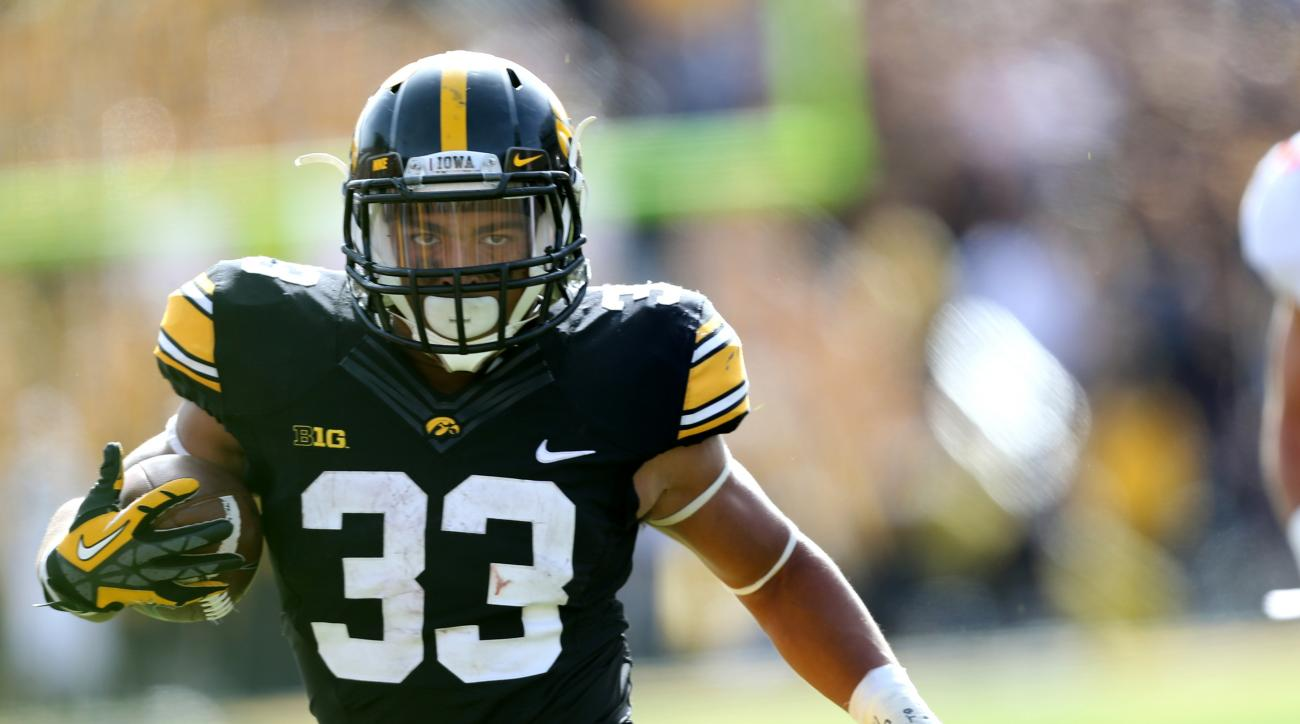 FILE - In this Oct. 10, 2015, file photo, Iowa running back Jordan Canzeri runs away an Illinois defender during the second half of an NCAA college football game in Iowa City, Iowa. Iowa reached its first Rose Bowl in 25 years despite a series of injuries