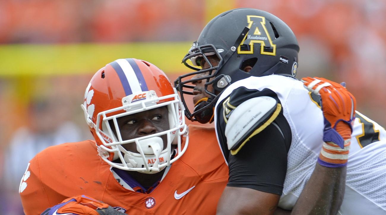FILE - In this Sept. 12, 2015, file photo, Clemson's Shaq Lawson (90) rushes against Appalachian State's Davante Harris during the second half of an NCAA college football game in Clemson, S.C. Before the Atlantic Coast Conference defensive player of the y
