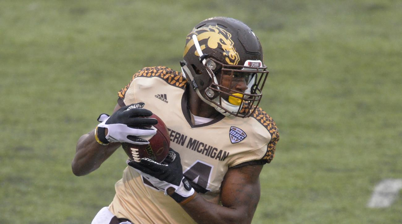 FILE -- In this Nov. 27, 2015, file photo, Western Michigan wide receiver Corey Davis runs with the ball for a 30-yard touchdown reception against Toledo in an NCAA college football game in Toledo, Ohio. The inaugural Bahamas Bowl last season featured a c