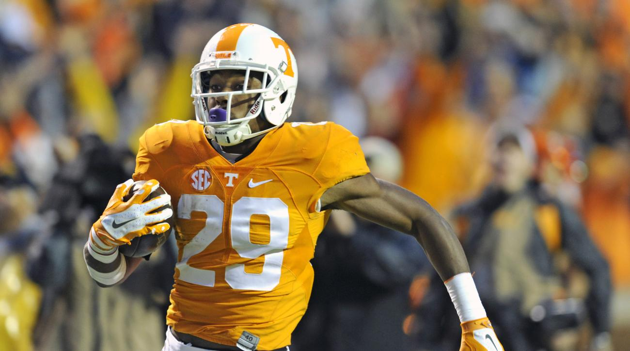 Tennessee's Evan Berry returns a kickoff for touchdown against Arkansas Saturday, Oct. 3, 2015, in Knoxville, Tenn. Berry and Cameron Sutton are aiming to give their departing special teams coach an ideal sendoff by accomplishing something that hasn't bee
