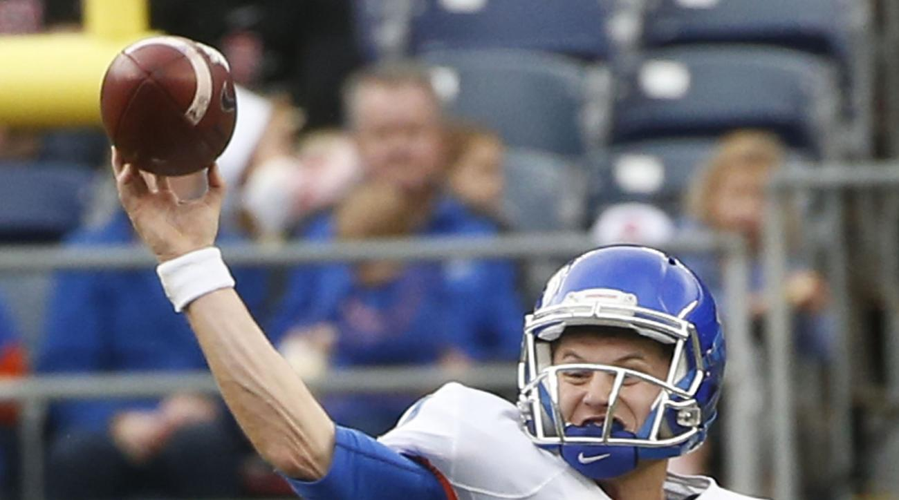 Boise State quarterback Brett Rypien is hit by Northern Illinois defensive end Perez Ford while releasing a pass during the first half of the Poinsettia Bowl NCAA college football game Wednesday, Dec. 23, 2015, in San Diego. (AP Photo/Lenny Ignelzi)