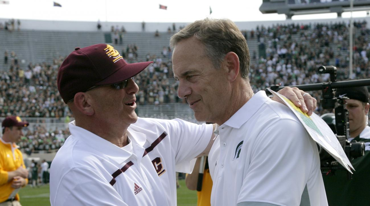 FILE - In this Sept. 26, 2015, file photo, Michigan State coach Mark Dantonio, right, and Central Michigan coach John Bonamego shake hands following an NCAA college football game in East Lansing, Mich. Central Michigan will play in the Quick Lane Bowl aga