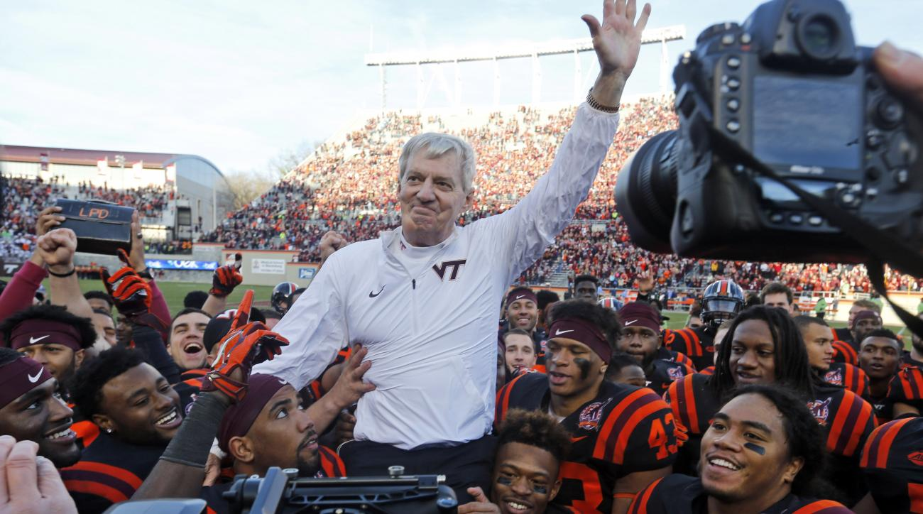 FILE - In this Saturday, Nov. 21, 2015, file photo, Virginia Tech head coach Frank Beamer is carried off the field by his players after an NCAA college football game against North Carolina, in Blacksburg, Va., in what was Beamer's last home game as coach