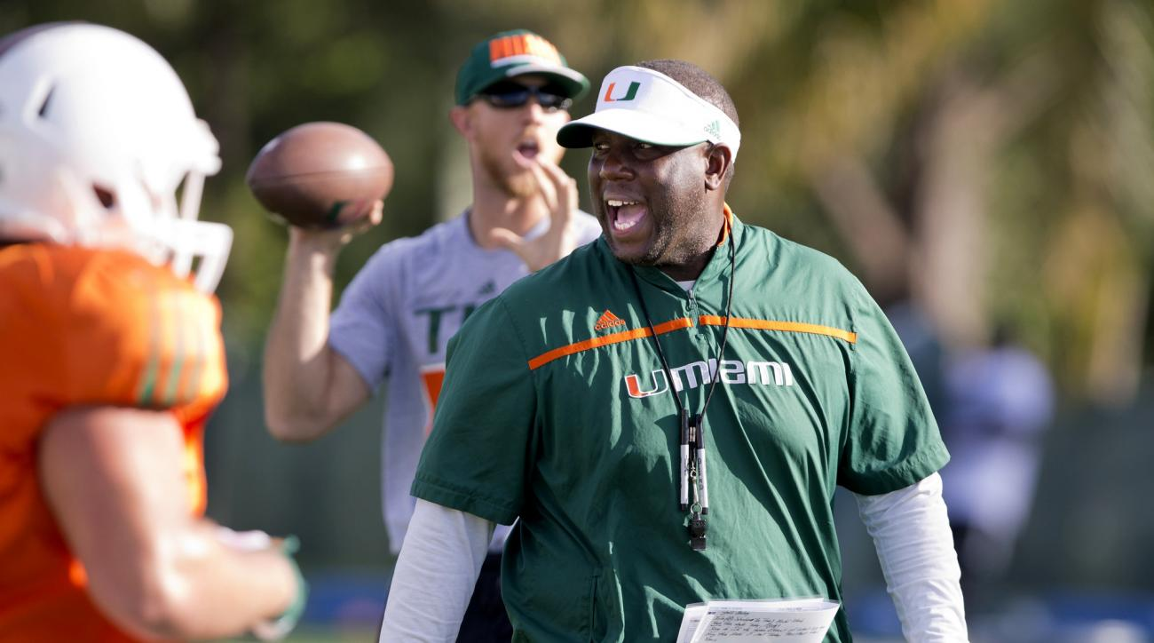 FILE - In this Tuesday, Oct. 27, 2015 file photo, Miami interim head coach Larry Scott leads an NCAA college football practice in Coral Gables, Fla. Miami has hired former Georgia coach Mark Richt as head coach. And Richt has begun to hire assistant coach