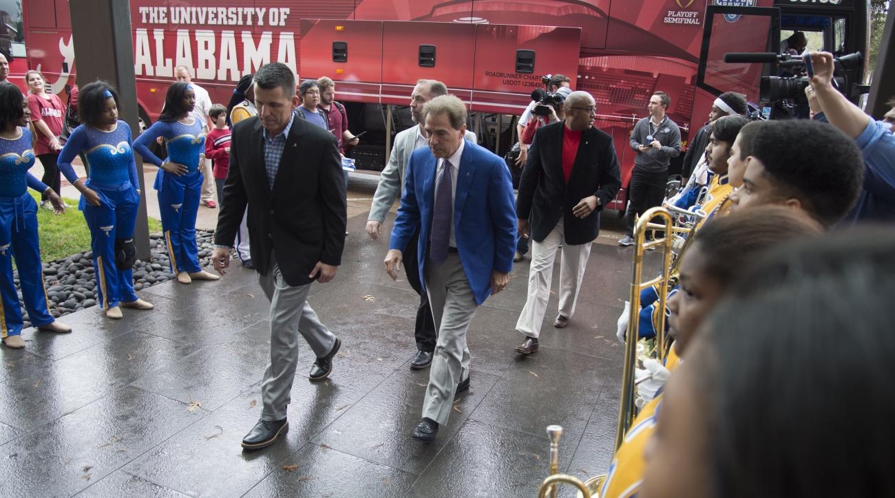 Alabama head coach Nick Saban arrives at the team hotel before the Alabama arrival press conference, Saturday, Dec. 26, 2015, at Hilton Anatole in Dallas. (Vasha Hunt/AL.com via AP) MAGS OUT; MANDATORY CREDIT