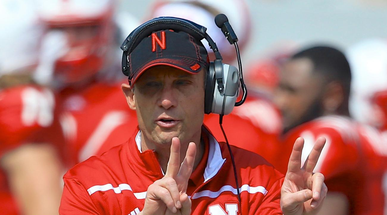 FILE - In this April 11, 2015, file photo, Nebraska head coach Mike Riley signals during the annual NCAA college football Red-White spring game in Lincoln, Neb. The move toward allowing wireless communication between coaches and players on the field in co