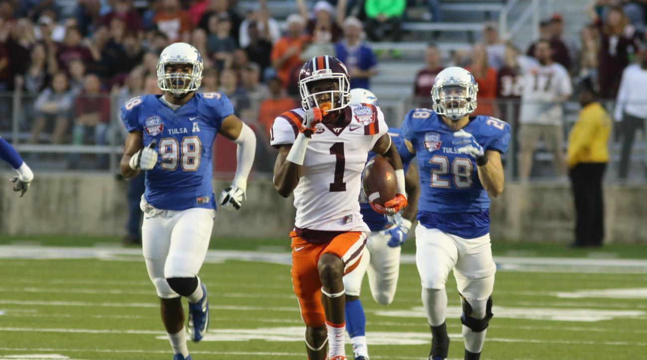 Virginia Tech's Isaiah Ford runs the ball in the first quarter against Tulsa to score a touchdown on Saturday, Dec. 26, 2015, at the Independence Bowl NCAA college football game in Shreveport, La. (AP Photo/Todd Yates)
