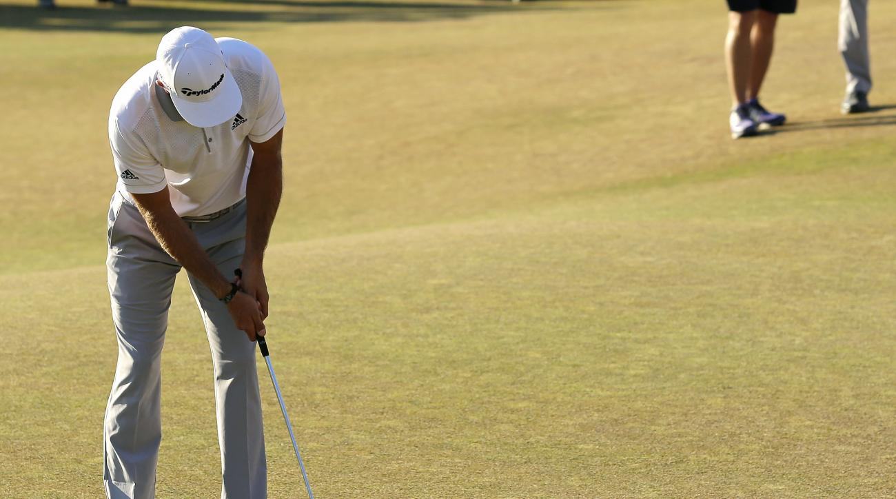 FILE -  In this June 21, 2015, file photo, Dustin Johnson three-putts on the 18th hole during the final round of the U.S. Open golf tournament at Chambers Bay in University Place, Wash. Johnson's hard-to-watch three-putt from 12 feet that cost him the tit