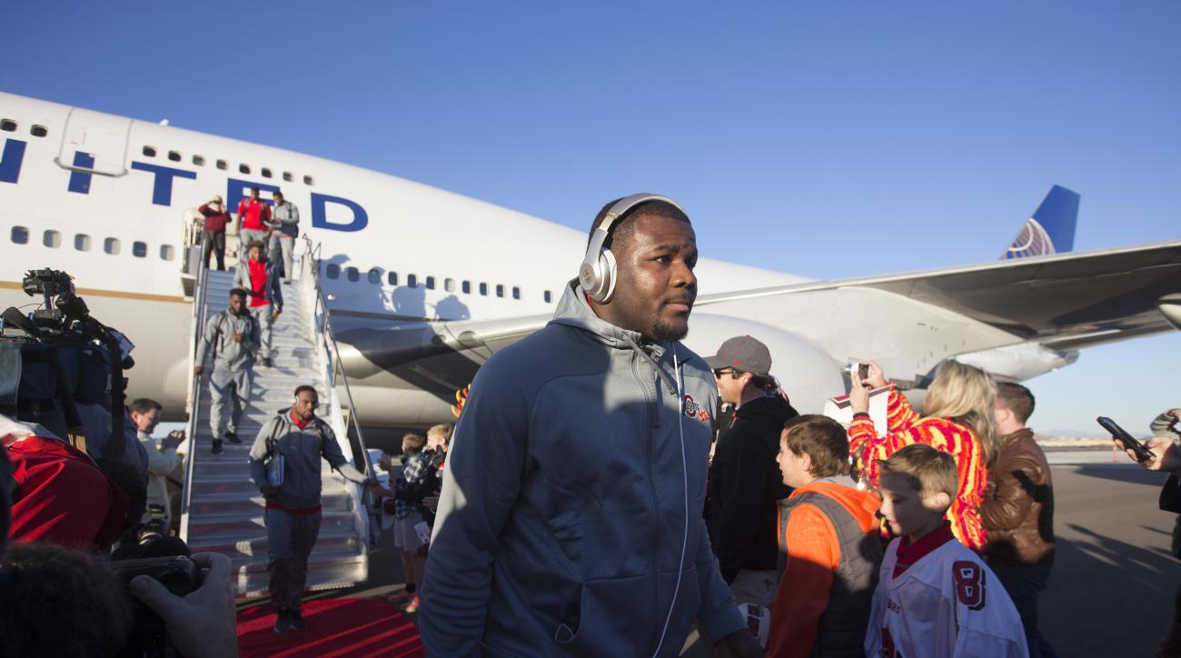 Ohio State quarterback Cardale Jones, center, and teammates disembark after arriving at an airport in Phoenix on Sunday, Dec. 27, 2015. Ohio State is scheduled to play Notre Dame in the Fiesta Bowl on New Year's Day. (Cheryl Evans/The Arizona Republic via