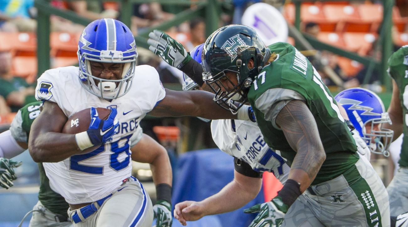 FILE - In this Oct. 31, 2015 file photo, Air Force running back Jacobi Owens (28) stiff-arms Hawaii linebacker Lance Williams (17) and runs in for a touchdown in the first quarter of an NCAA college football game in Honolulu. Air Force plays California in